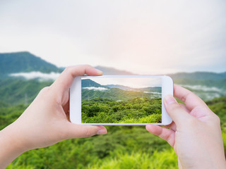 Taking photo of mountain landscape with clouds
