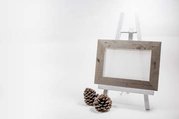 Blank picture frame on easel.Photo on white background with shadow.