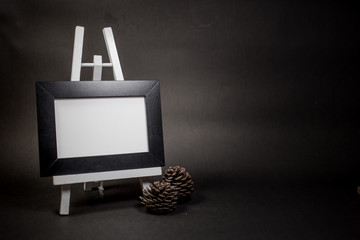 Blank picture frame on easel.Photo on black background.