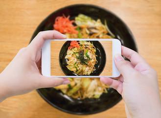 Taking photo of Yakisoba, japanese fried noodle