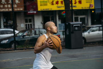 Man is about to throw basket ball