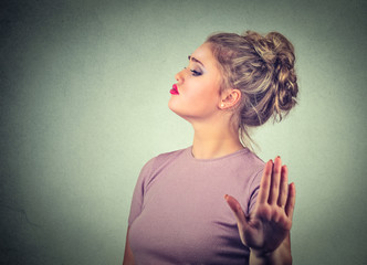Snobby annoyed angry woman giving talk to hand gesture