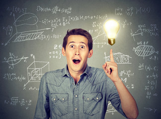 student with idea light bulb and high school maths formulas