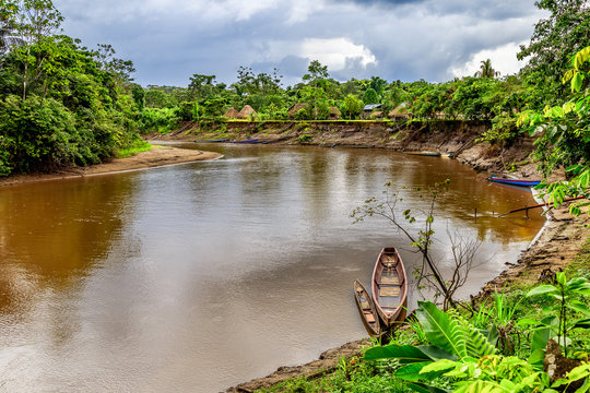 River with wooden boat in Amazonia , Cuyabeno , Ecuador