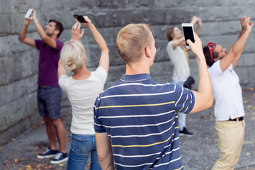 People taking picture with phones