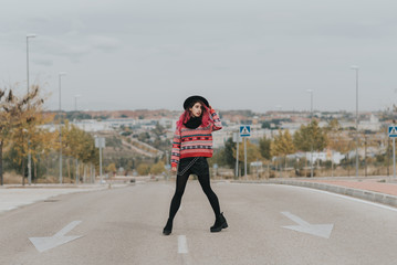 Pink hair woman standing on the road