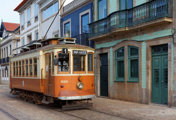 Old yellow Porto tramway in the side of Douro River in a day.Ipomoea purpurea ,