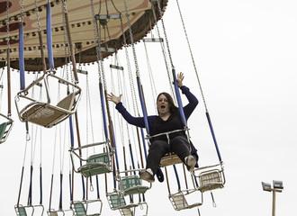 Woman on flying swings