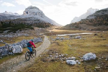 Woman mountain biking, Dolomites, South Tyrol, Italy