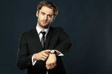 business man pointing at his watch