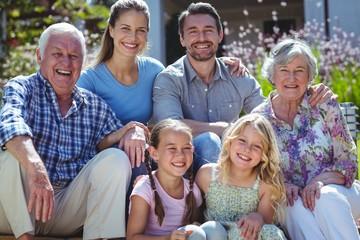 Portrait of happy family in back yard