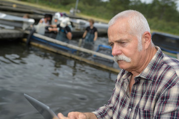 fish farm owner managing his team