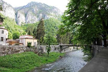 City landscape along Cerna River in Herculane, Romania
