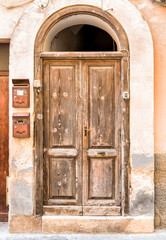 Old wooden door of the ancient house.