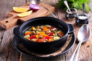... soup with wild mussels, potatoes, carrots, tomatoes, pepper and dill