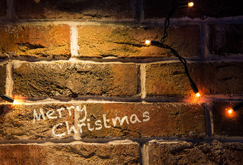 christmas brick wall background with lights glowing card