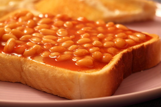 Baked beans on a slice of white toasted bread