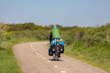 Cyclist on a bike path in the dunes Noordwijk