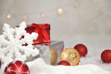 Christmas balls, gifts and snowflake on abstract background