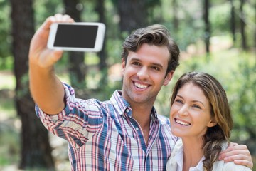 Happy couple clicking selfie with smart phone