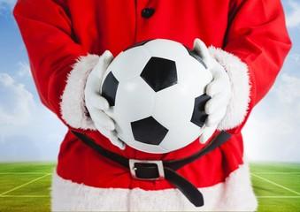 Santa claus holding a football