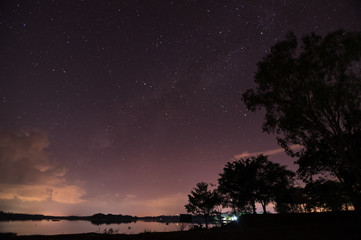 Beautiful starry night with milky way over the lake