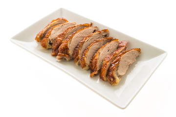 Grilled duck meat in white plate