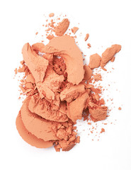 Orange color Face make up powder cracked on background