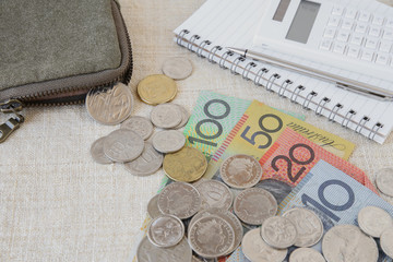 Australian money, AUD with calculator, notebook and small money