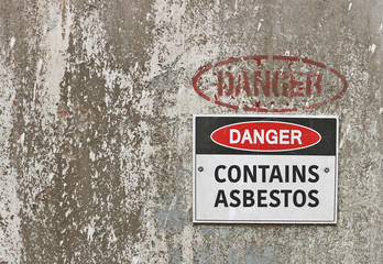 red, black and white Danger, Contains Asbestos warning sign