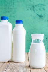 milk on a wooden table on Green background