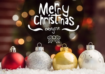 Composite image of christmas greetings with colorful baubles