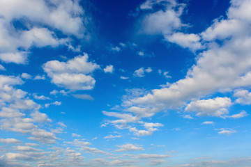 Soft focus clouds in the blue sky.