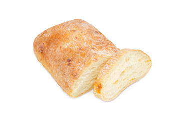 Partly sliced ciabatta on a light background