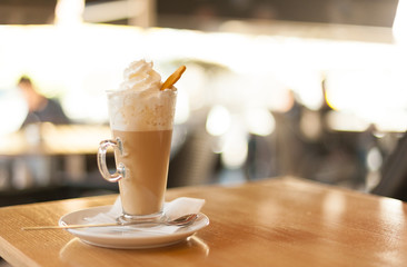 Cup of coffee latte with whipped cream and gingerbread