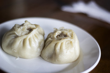Poses or buuza - traditional Buryat dumplings with meat.