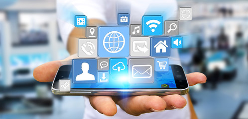 Businessman using modern digital icon application on his mobile