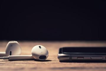 Headphone and phone media portable on dark tone.