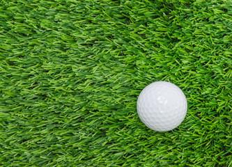 Golf ball on green grass.