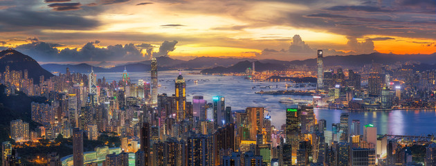 Wall Mural - Sunset over Victoria Harbor as viewed atop Victoria Peak with Ho