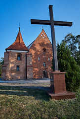 Cross and the Gothic medieval church in Poznan