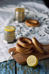 Mug of tea with bagels on a wooden background