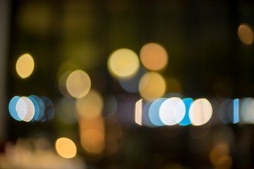 image of blurred bokeh background with colorful lights and Dark background