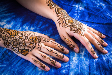mehendi on the hands on a blue background
