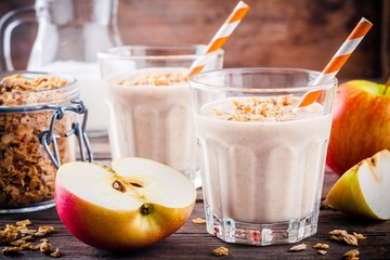 Healthy breakfast: smoothie with granola, red apple and milk