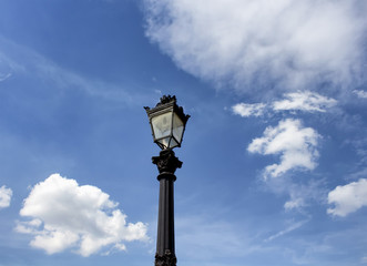 Fotomurales - Old, classical, historial street lamp with cloudy sky background in Paris.