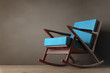 Rocking Chair Upholstered with Blue Cloth. 3d Rendering
