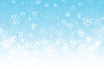 Vector of Christmas snowflakes on blue background for winter season.