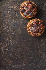 Lemon tartlet, pie, tart with fresh blueberries and milk chocola