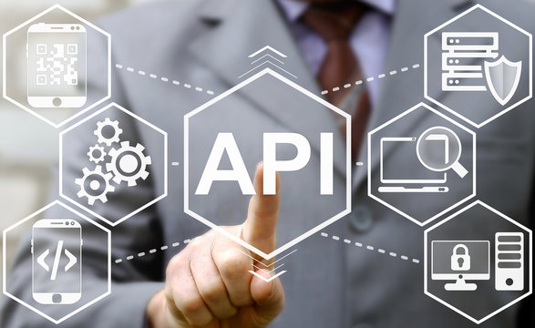 """businessman touched API acronym word icon on virtual screen on background of tech devices. Man presses button on touch screen interface and select """"API"""". Business, Internet and technology concept."""